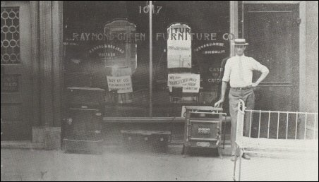 Cheap Storefront Proprietor Standing On The Sidewalk With Furniture Stores  In Kansas City Area